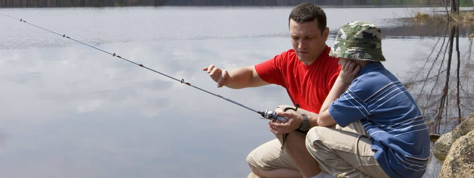 Corsi per imparare a pescare a Varese - Istruttore con bambino